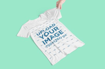 T-Shirt Mockup Featuring a Hand Holding a Tee Sleeve 3019-el1