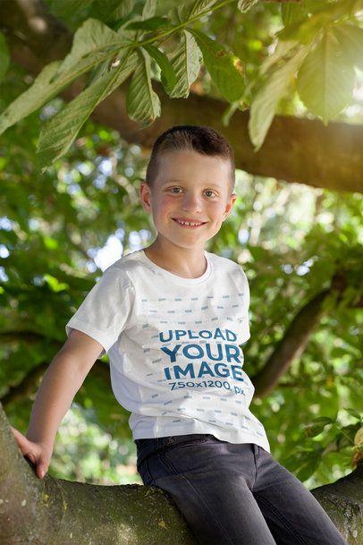 T-Shirt Mockup Featuring a Boy Sitting on a Tree 2926-el1