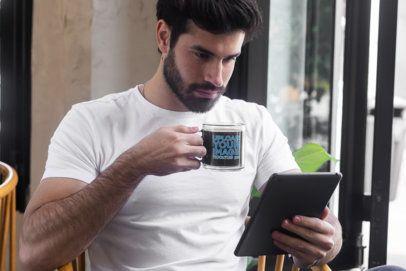 Glass Coffee Mug Mockup Featuring a Man Reading 31766