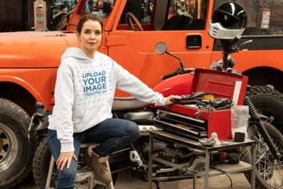 Pullover Hoodie Mockup Featuring a Biker Woman at a Garage 31851