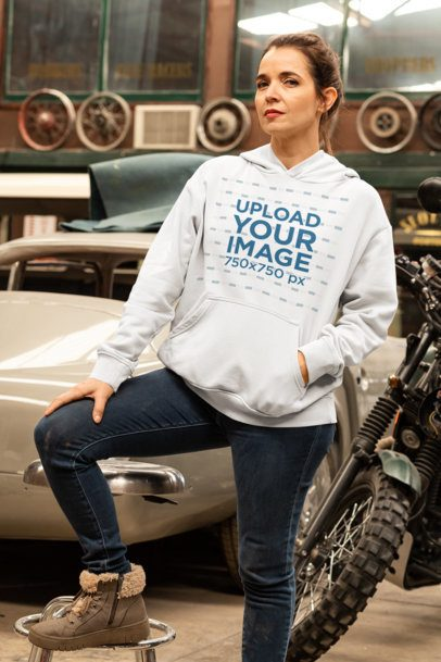 Pullover Hoodie Mockup of a Serious Woman Posing by a Car and a Motorcycle 31852