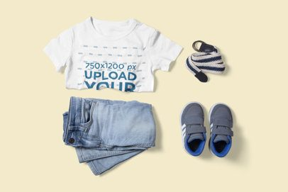 T-Shirt Mockup Featuring a Boy's Outfit on a Customizable Background 3001-el1