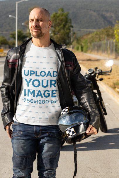 T-Shirt Mockup Featuring a Biker Carrying His Helmet 31785