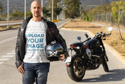 T-Shirt Mockup Featuring a Biker Posing Near His Motorcycle 31786
