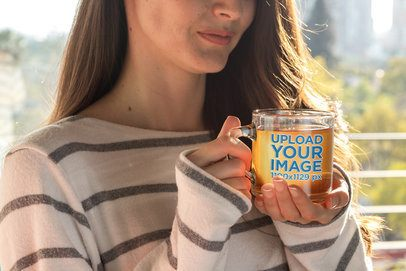 Mockup of a Woman Drinking Tea from an 11 oz Glass Mug 31757