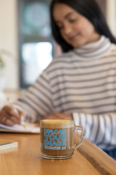 Clear Mug Mockup Featuring a Woman Writing on a Notebook 31741