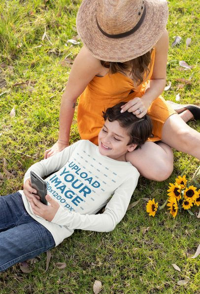 Long Sleeve Tee Mockup of a Boy Lying Down on the Grass with His Mom 32646
