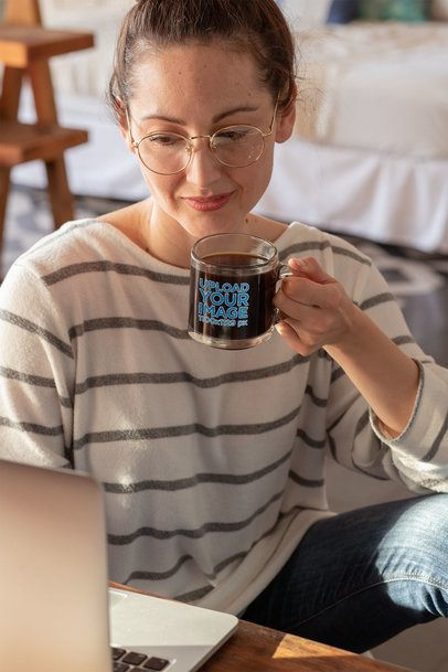 11 oz Glass Mug Mockup Featuring a Woman on Her Computer 31759