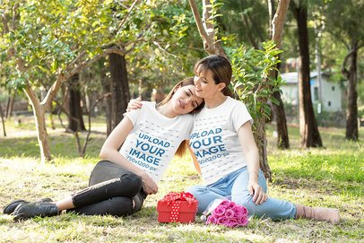 T-Shirt Mockup Featuring a Mom and Daughter Hugging at a Park 32666