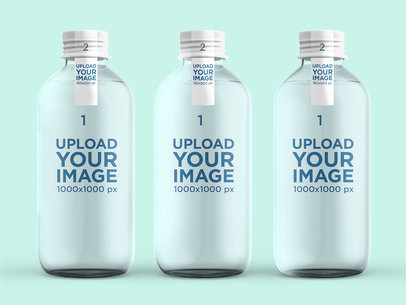 Mockup of Three Glass Water Bottles in a Plain Setting 3061-el1
