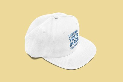 Mockup of a Fitted Hat Placed on a Solid Color Surface 3050-el1