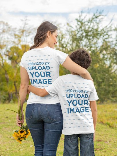 Back View T-Shirt Mockup Featuring a Mom and Son Hugging in the Park 32642