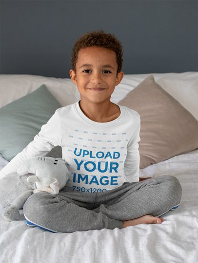 Long Sleeve Tee Mockup Featuring a Kid Sitting on a Bed by a Stuffed Elephant 31650