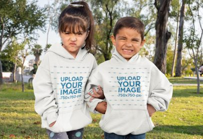 Mockup of Brother and Sister Wearing Hoodies at the Park 31669