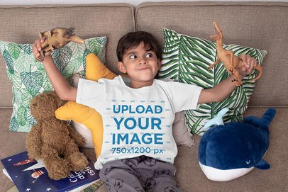 T-Shirt Mockup Featuring a Boy Playing with Dinosaur Toys 32167