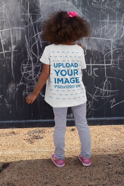 Back-View T-Shirt Mockup of a Girl Drawing on a Wall 32180