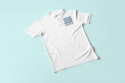 Mockup of a Polo Shirt Lying Flat on a Solid Color Surface 3093-el1