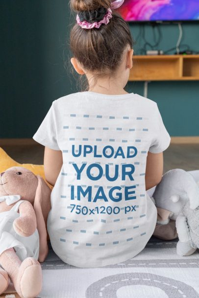 Back View T-Shirt Mockup Featuring a Little Girl Surrounded by Toys 31685