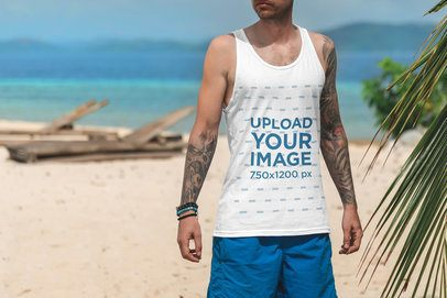 Cropped Face Mockup Featuring a Tattooed Man with a Tank Top at The Beach 3318-el1