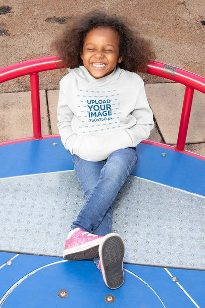 Mockup of a Happy Girl Wearing a Hoodie at a Playground 32188