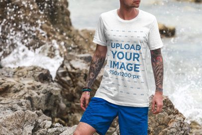 Mockup of a Man Wearing a Customizable T-Shirt Posing by Some Beach Rocks 3332-el1