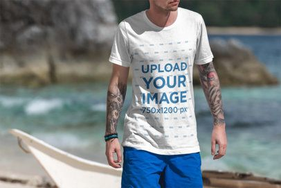 T-Shirt Mockup of a Tattooed Man Walking on the Beach 3333-el1
