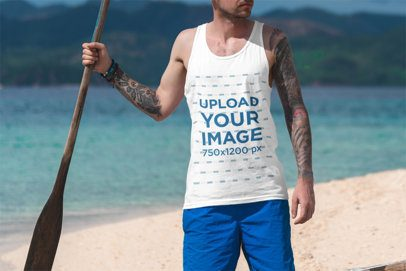 Tank Top Mockup of a Tattooed Man Holding an Oar By the Sea 3311-el1