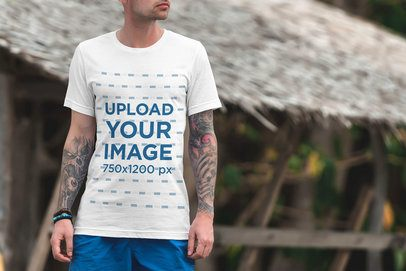 Mockup of a Tattooed Man Wearing a T-Shirt at the Beach 3345-el1