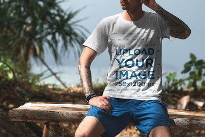 T-Shirt Mockup of a Man Relaxing at a Tropical Beach 3346-el1