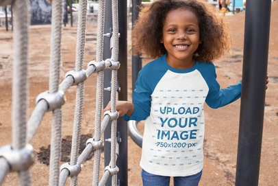 Raglan Tee Mockup of a Little Girl Playing at a Park 32183