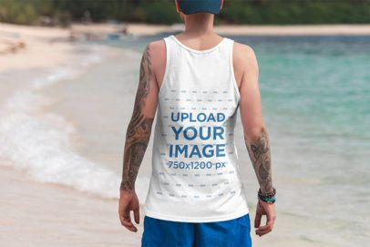 Back View Mockup of a Tattooed Man Wearing a Tank Top at a Tropical Beach 3335-el1