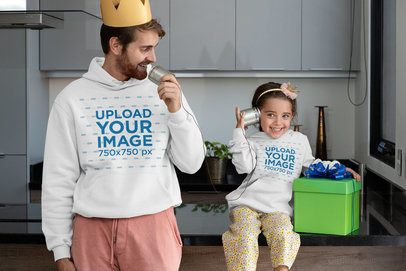 Hoodie Mockup Featuring a Man Playing With His Daughter on Father's Day 33091