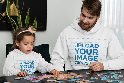 Hoodie Mockup of a Dad and His Daughter Doing a Puzzle 33095