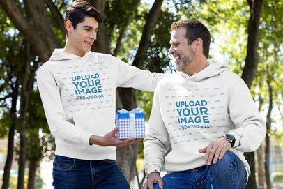 Hoodie Mockup Featuring a Man Giving His Father a Present 33087