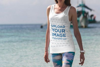 Tank Top Mockup of a Woman at the Beach with a Ship in the Background 3338-el1
