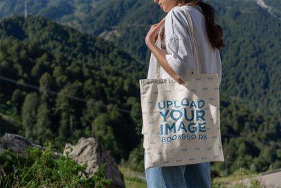 Tote Bag Mockup of a Woman at the Mountains 3134-el1