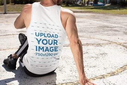 Back-View Mockup of a Man Stretching with a Tank Top 32550