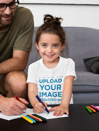 T-Shirt Mockup Featuring a Happy Girl Drawing With Her Dad 33075