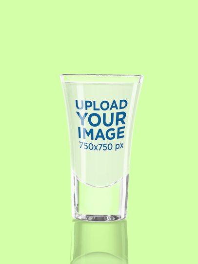 Shot Glass Mockup Featuring a Plain Color Background 3222-el1