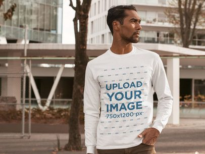 Mockup of a Serious Man Wearing a Customizable Long Sleeve Tee in the City 31833