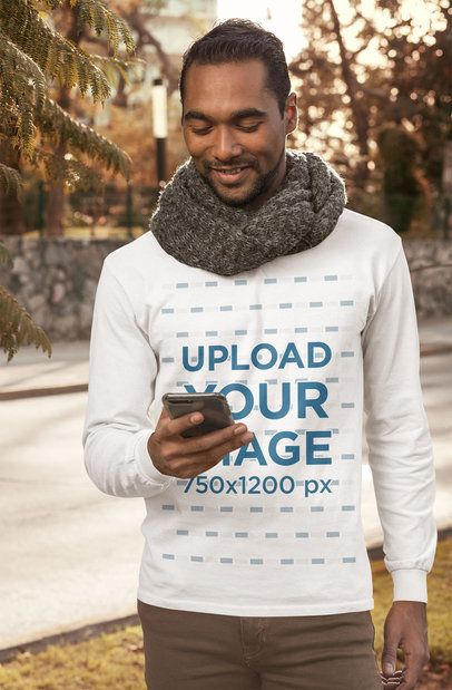 Long Sleeve Tee Mockup Featuring a Bearded Man Checking His Phone on the Street 31834
