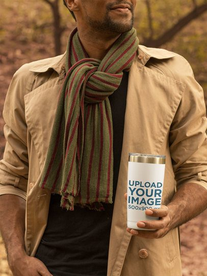 Mockup of a Young Man Holding a Travel Mug 31838
