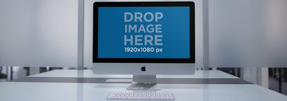 iMac Wideshot Mockup at a Modern Office Desk a12337
