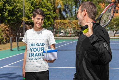 T-Shirt Mockup of a Man Giving a Present to His Dad After a Tennis Match 33109