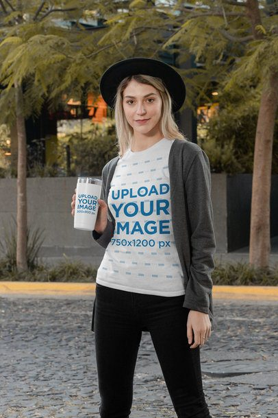 T-Shirt Mockup of a Stylish Woman Holding a Travel Mug 31819