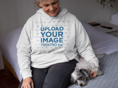 Mockup Featuring a Senior Woman Sitting on a Bed Next to a Small Dog 32214