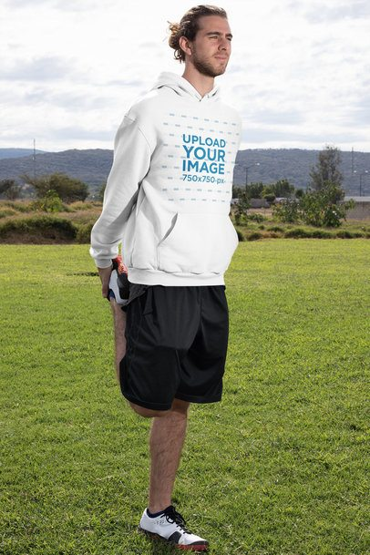 Pullover Hoodie Mockup of a Man Warming Up Outside 32311