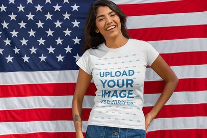 Mockup of a Happy Woman Wearing a Customizable T-Shirt in Front of an American Flag 33016
