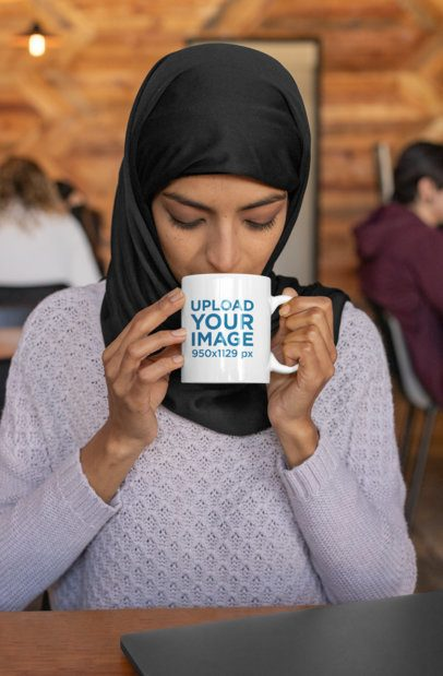 11 oz Mug Mockup of a Woman Wearing a Hijab and Drinking Coffee 32391