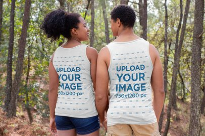 Back View Mockup of a Couple Wearing Tank Tops in Nature 32369